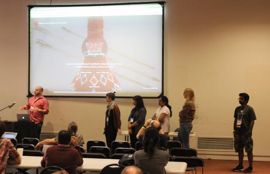 The I School team presents their project to the hackathon judges and audience.