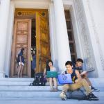 studnets sitting on steps at UC Berkeley