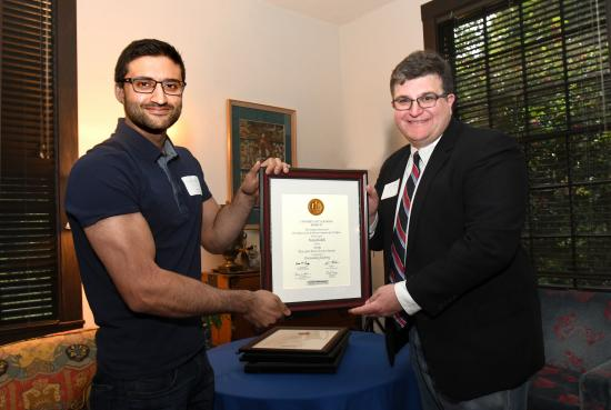 Nitin Kohli and Associate Dean of Graduate Division Eric Falci.
