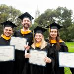 MIDS students with awards in front of Campanile