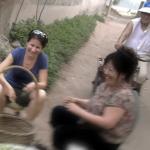 Elisa Oreglia (left) interviews local women in a village in the Hebei province