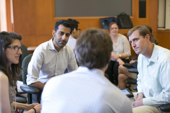 "MIDS students gathered in groups to brainstorm ""Best Practices of Authentic Leaders."""