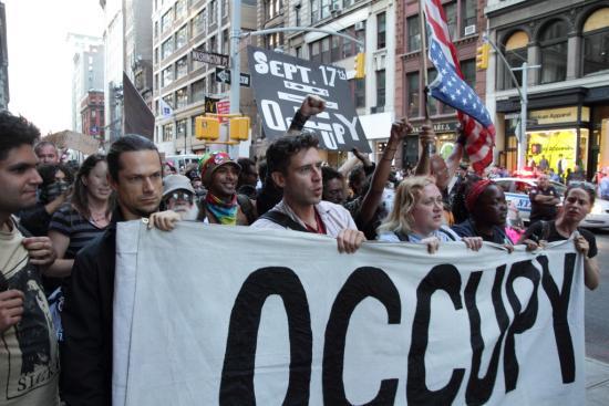 """Occupy Wall Street <br />(photo by <a href=""""http://flic.kr/p/db5eN3"""">Paul Stein</a>)"""