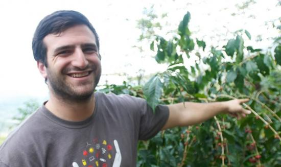 Ariel Chait with a coffee plant in Chiapas, Mexico