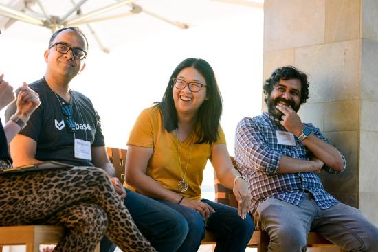 Thejo, Holly, and Prayag speak on a panel at an I School Meet Up in the South Bay