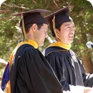 """Student speakers Igor Pesenson (left) and Kevin Lim, wearing what they described as """"our new wizard costumes"""" (photo: Kesava Mallela)"""