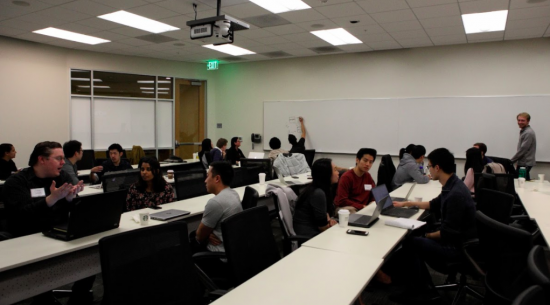 Delta Analytics' January 2018 Kick Off Event for Fellowship Projects, including Medic Mobile; Pictured: multiple people sitting at long tables