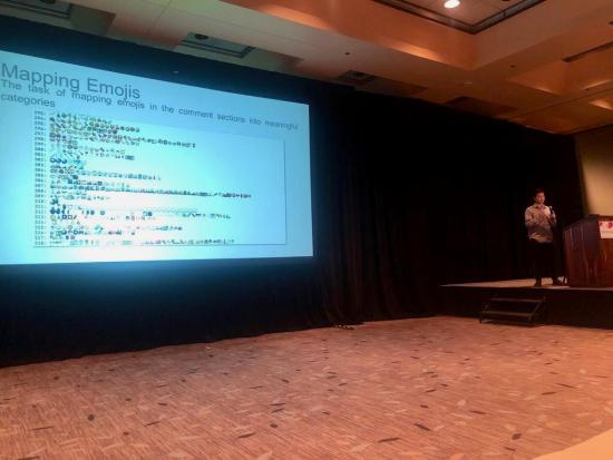 Man presenting at technical conference