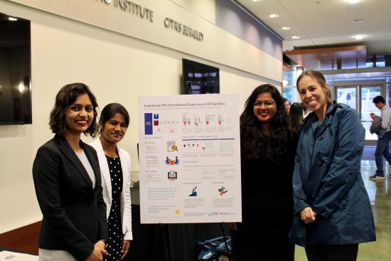 3 MIMS students with their advisor, Professor Burrell, and their project poster