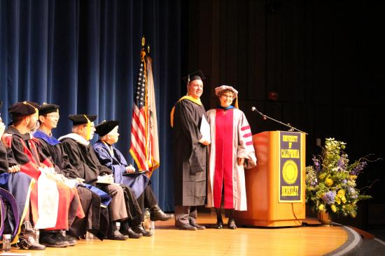 """MIDS student Mike Frazzini accepts the award for """"SoundFlux"""" from Dean Anno Saxenian"""