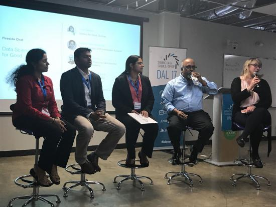 Sudha Subramanian part of a panel discussion fireside chat at a Domino Data Science Pop-Up in Dallas: Pictured: 5 individuals sitting on a panel