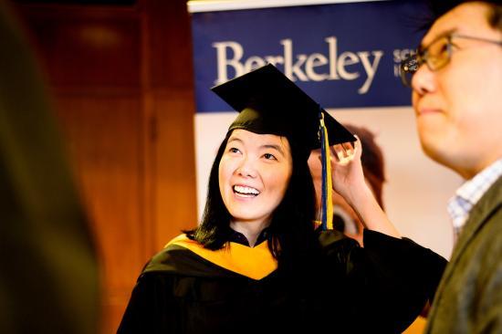 graduating student smiling