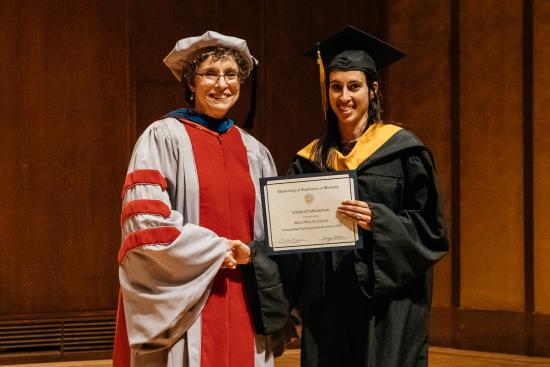 Dean Saxenian with Outstanding Teaching Assistant (MIDS) award-winner: Maya Miller-Vedam