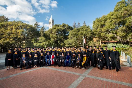 Group of graduates with faculty