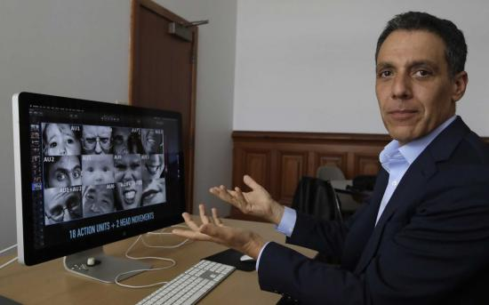 Hany Farid gestures as he views video clips in his office at South Hall in UC Berkeley