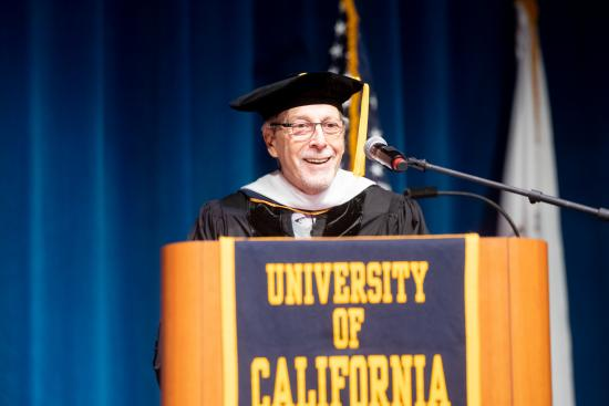Geoff Nunberg speaking at graduation