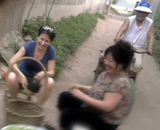 Ph.D. student Elisa Oreglia (left) interviews local women in a village in China's Hebei province