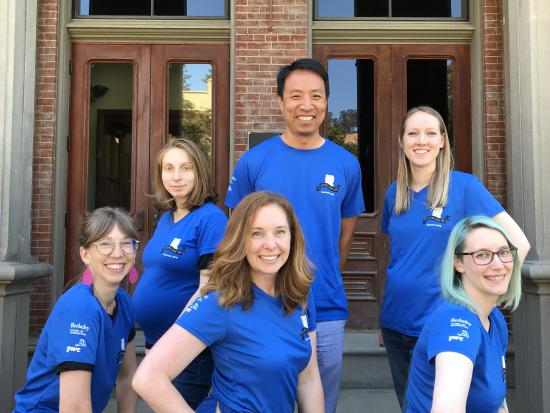 I School staff pose in front of South Hall in their 5K tees