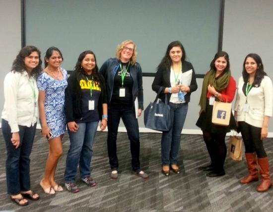 The I School hackathon team, with judges Sarah Clatterbuck and Komal Mangtani (center)