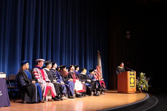 MIMS student Soravis Prakkamakul speaking at graduation