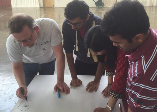 A mentor from World Programming helps the team design the project's logistics.