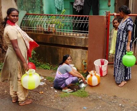 Women in Hubli, India, store water in pails because running water is not always available throughout the course of the day.
