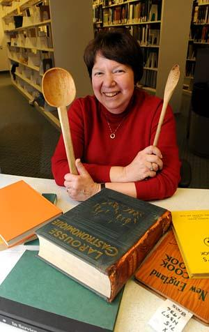 Norma Kobzina at Berkeley's Natural Resources Library, which includes the culinary collection. (Peg Skorpinski photo)