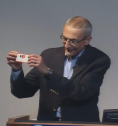 John Podesta shows off his EFF membership card, which shows that he was Member #33.