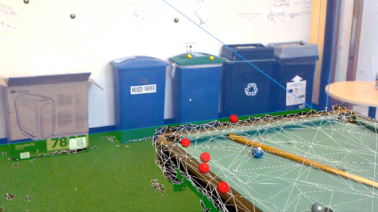 A pool table with a mesh overlay and several red balls representing audio beacons