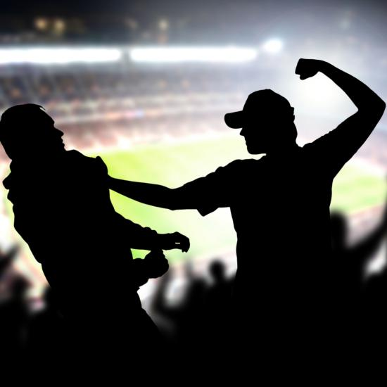 Man about to throw a punch in a stadium