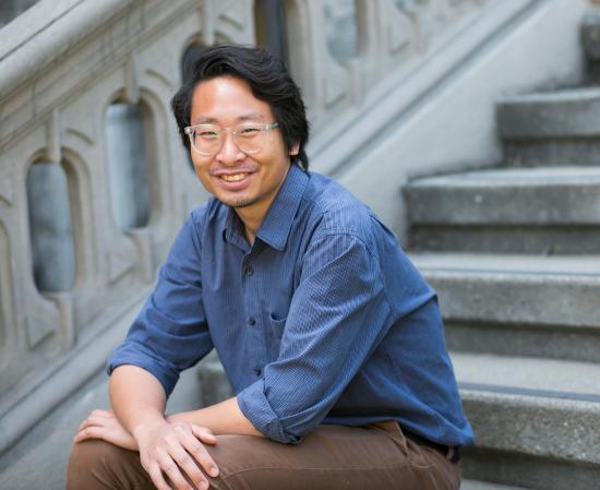 Soravis Prakkamakul sitting on steps in front of South Hall