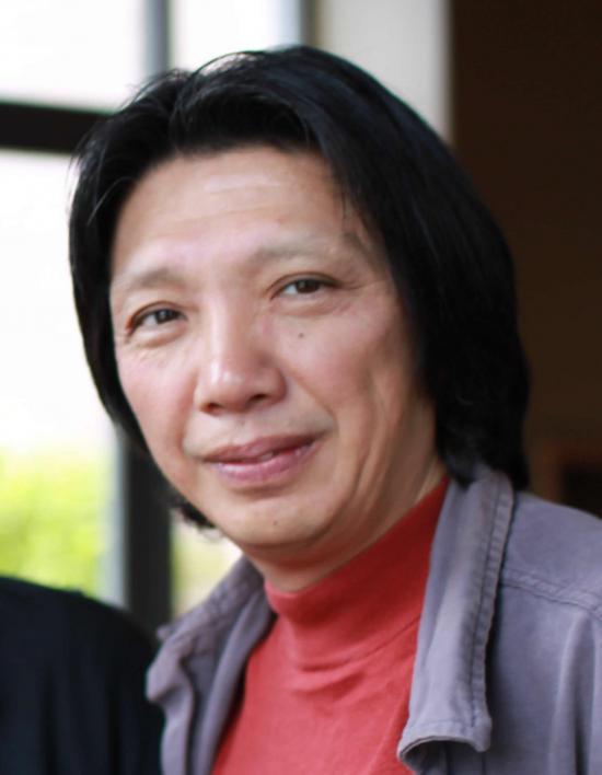 "Xiao Qiang <br />(photo:  <a href=""https://flic.kr/p/6L4xy2"">Elliott Ng, CNReviews</a>)"